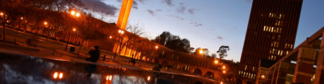 A view of the reflecting pool in front of Leavey Library at dusk.